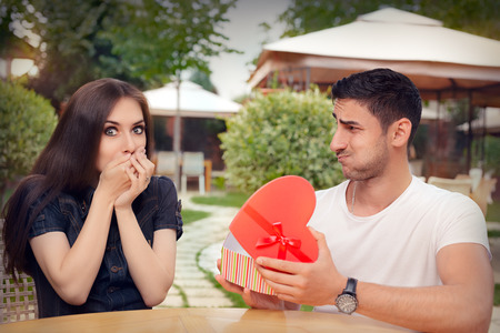 declaring: Happy Girl Receiving Heart Shaped Gift from her Boyfriend
