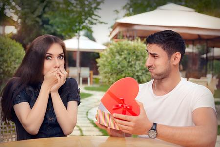 honeymooners: Happy Girl Receiving Heart Shaped Gift from her Boyfriend