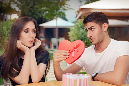 feel affection: Surprised Girl Receiving Heart Shaped Gift from her Boyfriend