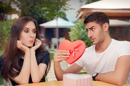 honeymooners: Surprised Girl Receiving Heart Shaped Gift from her Boyfriend