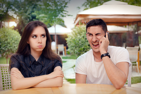 Girl Feeling Bored while her Boyfriend is on The Phone Standard-Bild