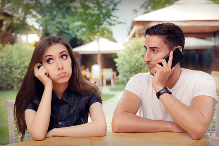 bad boy: Girl Feeling Bored while her Boyfriend is on The Phone Stock Photo