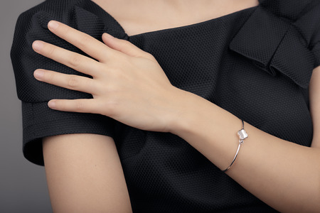 Close up Detail of a Bracelet on a Female Hand Model
