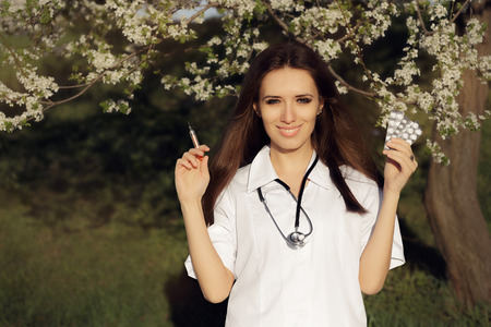 anti season: Spring Female Doctor Deciding with  Vaccine Syringe and Pills