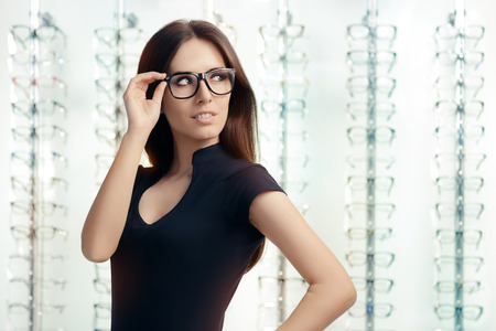 myopia: Young Woman with Eyeglasses in Optical Store