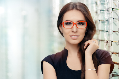Young Woman with Eyeglasses in Optical Store