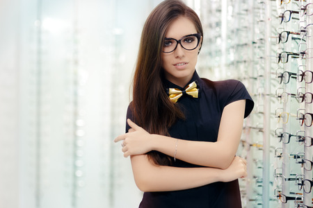 cat eye: Elegant Bowtie Woman with Cat Eye Frame Glasses in Optical Store