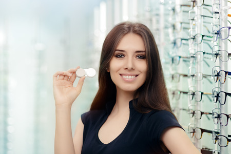 show case: Woman with Contact Lenses Case in Optical Store Stock Photo