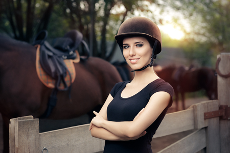 Happy Female Jockey Smiling Stock Photo