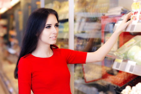store shelf: Woman Shopping at Shelf in Supermarket Store