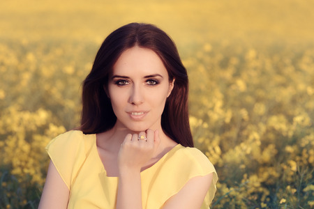 brunette girl: Summer Woman in Yellow Floral Landscape