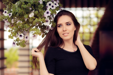 personable: Portrait of a Beautiful Young Woman Outside Stock Photo