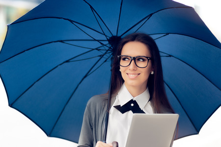Happy Woman with Glasses, Tablet and Umbrella Out in the City