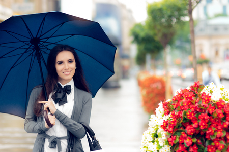 Happy Woman Holding Umbrella Out in the City