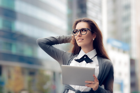 woman wearing glasses: Urban Woman Wearing Glasses Holding  PC Tablet Stock Photo
