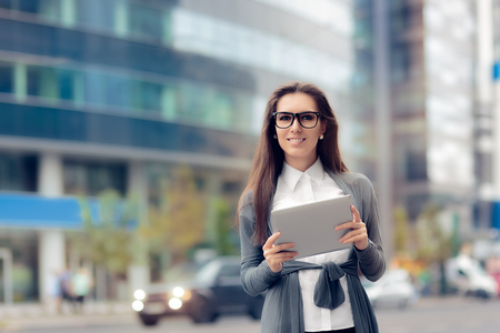 press agent: Urban Woman Wearing Glasses Holding  PC Tablet Stock Photo