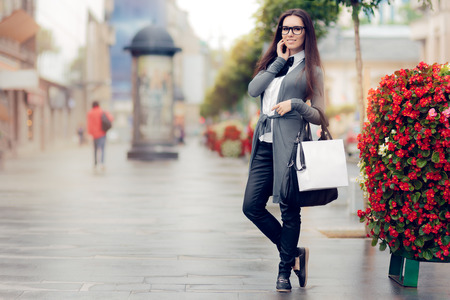 shoes woman: Urban  Woman With Shopping Bags Outside Stock Photo