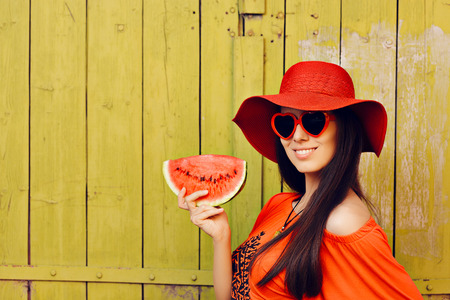 sun glasses: Girl with Sunglasses and  Red Hat with Watermelon Slice Stock Photo