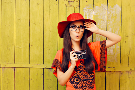 camera girl: Funny Girl with Retro Photo Camera and Red Sun Hat