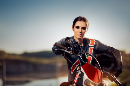 Risk Free: Female Motocross Racer Next to Her Motorcycle