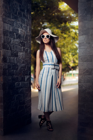 presumptuous: Woman in Summer Dress with Stripes Wearing Sunglasses and Hat