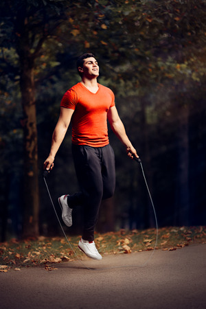 Fitness Man Skipping Rope Outdoors in Nature Reklamní fotografie