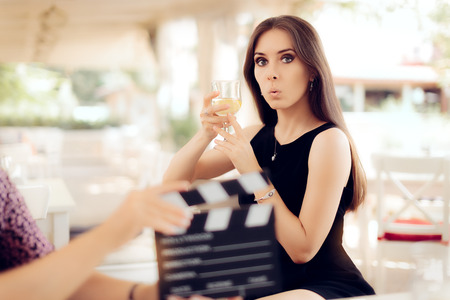 actress: Surprised Actress Holding a Glass in Movie Scene