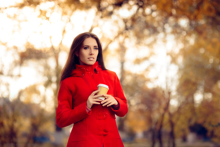 caffeine free: Autumn Woman Holding Coffee Cup Outside in Nature