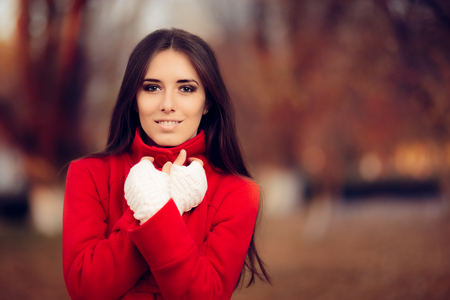 fingerless gloves: Autumn Woman Wearing Red Coat and Knitted Fingerless Gloves Stock Photo