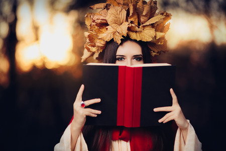 magical forest: Woman With Autumn Leaves Crown Reading a Book