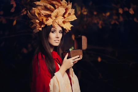 brunette woman: Autumn Woman Holding Treasure Box with Big Diamond