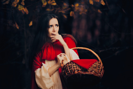 caperucita roja: Scared Little Red Riding Hood Hiding in the Forest