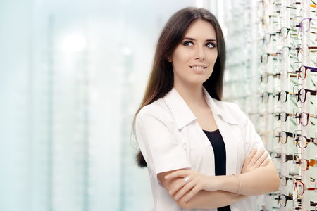 Happy Optician Standing in Optical Store Stock Photo
