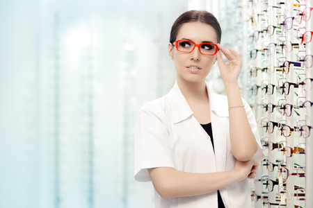 health professional: Happy Optician Standing in Optical Store Stock Photo