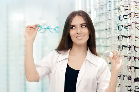 Happy Optician Choosing between Glasses and Contact Lenses Stock Photo