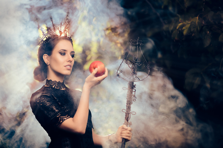 Evil Queen with Poisoned  Apple in Misty Forest Фото со стока - 62925379