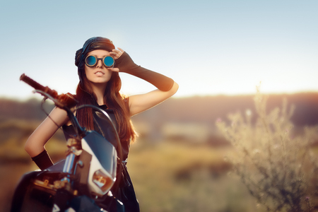 Cosplay Steampunk Woman Next to Her Motorcycle Stock Photo