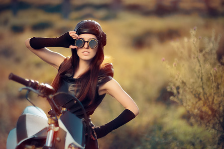 Cosplay Steampunk Woman Next to Her Motorcycle 版權商用圖片