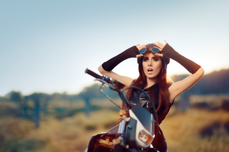 steampunk goggles: Surprised Steampunk Woman Next to Her Motorcycle