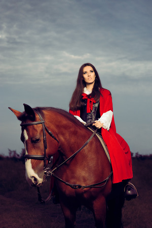 road warrior: Beautiful Princess with Red Cape Riding a Horse