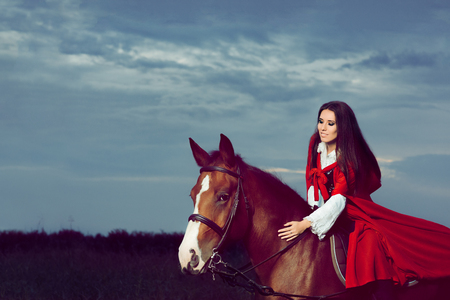 historical: Beautiful Princess with Red Cape Riding a Horse