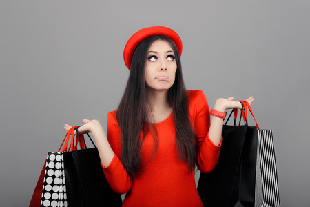 indecisive: Undecided  Woman with Shopping Bags Stock Photo