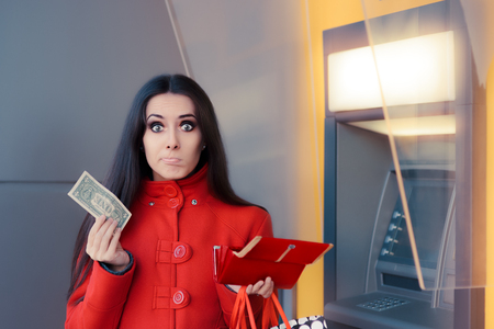 bankomat: Broke Woman Holding One Dollar in Front of an ATM