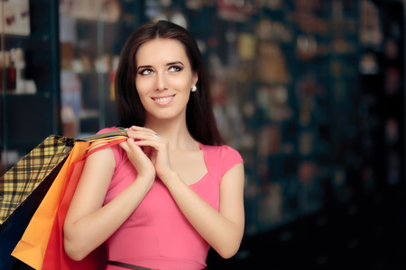 retail therapy: Happy Woman Shopping in a Store Stock Photo