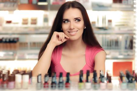 Happy Girl Choosing Between Bottles of Nail Polish