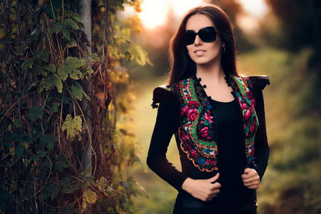 Fashion Woman With Sunglasses and Floral Vest