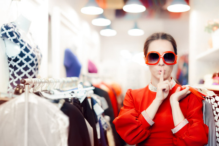 Shopping with Big Sunglasses Woman Keeping a Secret Archivio Fotografico