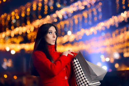 spender: Curious Woman With Shopping Bags in Christmas Market
