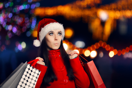 spender: Surprised Christmas Woman With Shopping Bags