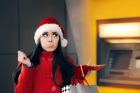 checking account: Funny Christmas Woman Holding a Coin